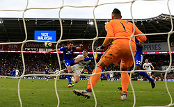 Burnley's Sam Vokes (centre) scores his side's second goal of the game during the Premier League match at the Cardiff City Stadium.