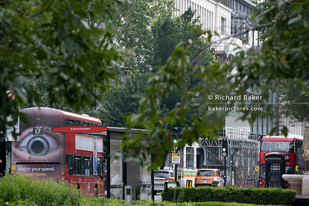 A number 17 London bus drives through the City of London with a large eye on the rear urging motorists to reduce their speeds on the capital's roadson 24th June 2021, in London, England. (Photo by Richard Baker / In Pictures via Getty Images) CREDIT RICHARD BAKER.