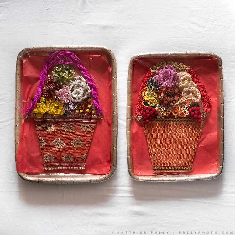 """Embroidery in the shape of bags. Traditional wedding gifts are prepared by the grrom's family for the bride. <br /> Called """"Saipata"""", they come in pairs as it is considered auspicious."""