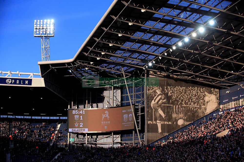 General view of the fans in the stands as the sun sets during the Emirates FA Cup, Fifth Round match at The Hawthorns, West Bromwich.
