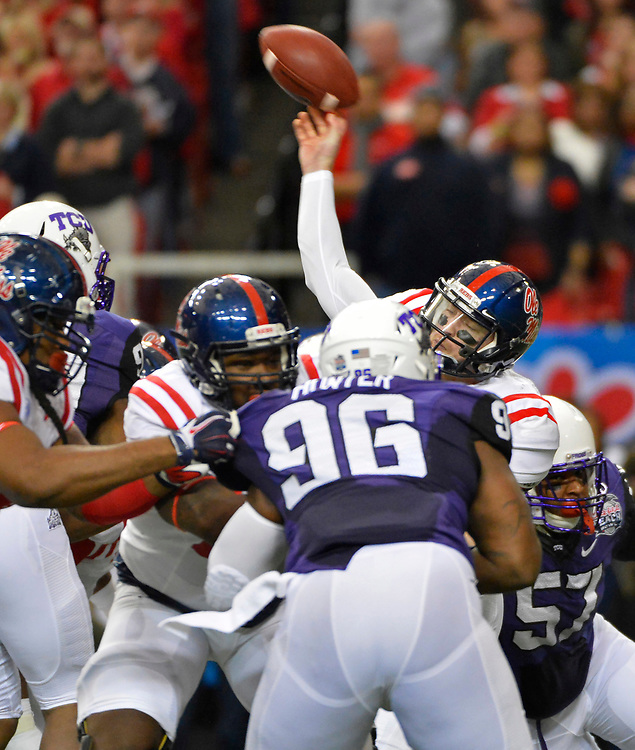 Mississippi Rebels quarterback Bo Wallace (14) passes under pressure against TCU in the first half of the Chick-fil-A Peach Bowl football game at the Georgia Dome on December 31, 2014. David Tulis / Abell Images for the Chick-fil-A Bowl