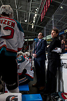 KELOWNA, CANADA - FEBRUARY 23: Assistant coach Kris Mallette and athletic therapist Scott Hoyer stand on the bench against the Seattle Thunderbirds  on February 23, 2018 at Prospera Place in Kelowna, British Columbia, Canada.  (Photo by Marissa Baecker/Shoot the Breeze)  *** Local Caption ***