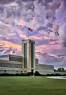 Storm clouds over the historic Campana Building take on a strange color due to the setting sun.   Aspect Ratio 1w x 1.437h