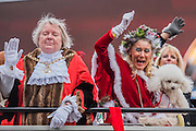 On the mayors bus, some are having more fun than others - The New Years day parade passes through central London form Piccadilly to Whitehall. London 01 Jan 2017