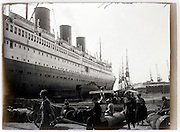 passenger ocean liner moored in harbor 1930s