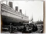 passenger ocean liner moored in harbor 1930s