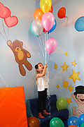 Young girl plays in a kindergarten playroom. Model Release Available
