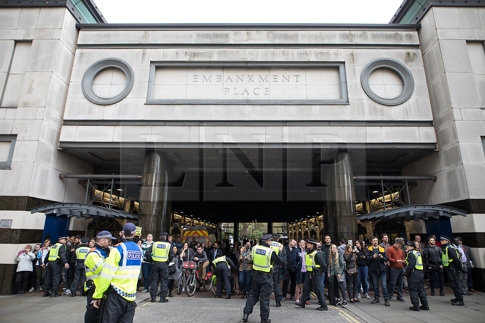 © Licensed to London News Pictures . 01/04/2017 . London , UK . Police detain pedestrians at Embankment Place on Victoria Embankment whilst the demonstrations pass along Victoria Embankment below . The EDL and Britain First both hold demonstrations in London , opposed by anti-fascist groups , including Unite Against Fascism . Photo credit : Joel Goodman/LNP
