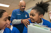 Former NBA play John Lucas signs a student's t-shirt during a financial education and success program sponsored by NBA Cares and BBVA Compass at Crespo Elementary School, February 27, 2014.