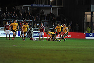 Newport county players celebrate the goal from Max Porter (on ground, 3rd right) as he makes the score 1-1. Blue Square Bet Premier division, Newport County FC v Wrexham at Rodney Parade in Newport, South Wales on Friday 4th Jan 2013. pic by Andrew Orchard, Andrew Orchard sports photography,