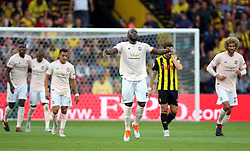 Manchester United's Romelu Lukaku (centre)celebrates his side's second goal of the game during the Premier League match at Vicarage Road, Watford