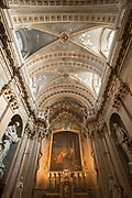 Low angle view on interior of Grasse Cathedral dome and altar with painting, host and statues, Notre-Dame-du-Puy de Grasse, Grasse, France
