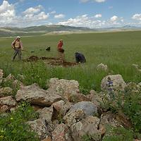 MONGOLIA. Smithsonian Museum archaeology team studies 2700+ year-old,  khirigsur burial mound at Ulaan Tolgai site near Lake Erkhel & Muren.  <br /> <br /> MS0702_060630_0240.NEF