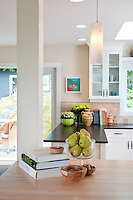 Artist Ginny Glover and her husband David Stuart have renovated a small bungalow in Ten Mile Point and infused it with contemporary style.