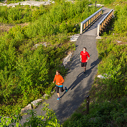 A woman and her teenage son trail running on the summit of Mount Agamenticus in York, Maine.