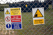 Danger signs on fence of sewage works Sutton Heath, Suffolk, England