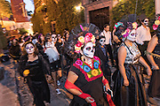 Hundreds of people dressed as the skeleton bride La Calavera Catrina parade during the final day of the Day of the Dead festival November 2, 2016 in San Miguel de Allende, Guanajuato, Mexico. The week-long celebration is a time when Mexicans welcome the dead back to earth for a visit and celebrate life.