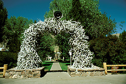 WY: Elk and deer antlers arch in Jackson Hole near Grand Teton National Park, Wyoming       .Photo Copyright: Lee Foster, lee@fostertravel.com, www.fostertravel.com, (510) 549-2202.Image: wygran212
