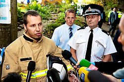 © licensed to London News Pictures  15/09/2011 . Pontardawe,UK...Picture: Superintendent Phill Davies and Chris Margetts From Mid and West Wales Fire & Rescue  at press conferance held at the end of a lane around two miles away from trapped miners. .. An operation in underway to rescue four miners trapped in a mine in the Swansea Valley. Photo credit :Aled Llywelyn/LNP