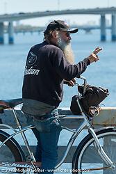 Pete from the Iron Horse Saloon heads over the Main Street Bridge during Daytona Beach Bike Week, FL., USA. March 9, 2014.  Photography ©2014 Michael Lichter.