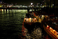 """Yakatabune boats on the Sumida River - """"yakatabune asobi"""" - meaning something like """"roofed-boat fun"""" is a pleasure synonymous with summer in Tokyo..The boats were first used exclusively by aristocrats and samurai from the eighth century, but nowadays anyone with the yen can enjoy. .They have always been closely associated with Tokyo Bay and the Sumida River"""