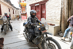 Led Sled's Pat Patterson riding a Royal Enfield Himalayan during Motorcycle Sherpa's Ride to the Heavens motorcycle adventure in the Himalayas of Nepal. On the fourth day of riding, we went from Kalopani to Muktinath. Thursday, November 7, 2019. Photography ©2019 Michael Lichter.