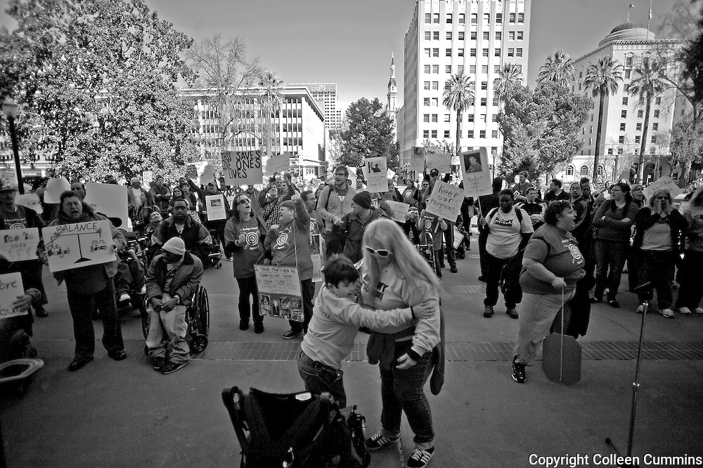 After 2 days of marching through the northern Sacramento valley Alex, Mary and hundreds of supporters of disabled rights reached the steps of the State capital. In February of 2011 Mary, driven by years of budget cuts in California began to fear that the Lanterman Act would be stripped. The Lanterman Developmental Disabilities Act was passed in 1977. It gives people with developmental disabilities the rights to services and supports that enable them to live an Independent normal life. Mary organized a grassroots march with caretakers and their disabled loved ones from her Yuba City home, 40 miles from the state capital Sacramento, under the name Mommy Tsunami.