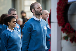 London, UK. 10 November, 2019. Ben Griffin stands in front of the Cenotaph after laying a white poppy wreath on behalf of fellow ex-services personnel from Veterans For Peace UK (VFP UK) taking part in the Remembrance Sunday ceremony in Whitehall. VFP UK was founded in 2011 and works to influence the foreign and defence policy of the UK for the larger purpose of world peace.