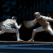 A blur of motion as Alexey Cheremisinov, Russia, (left) competes with Alexander Massialas, USA, in the Men's Foil Individual event during the Fencing competition at ExCel South Hall during the London 2012 Olympic games. London, UK. 31st July 2012. Photo Tim Clayton