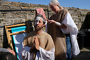 Extinction Rebellion Activists The Penitents, protest about the climate emergency on 11th August 2019 in St Ives, United Kingdom. The Penitents who were a Christian movement that goes back to the 4th century. Those who had committed serious sins confessed their sins to the Bishop or his representative and were assigned a penance that was to be carried out over a period of time. These protests are highlighting that the government is not doing enough to avoid catastrophic climate change and to demand the government take radical action to save the planet.