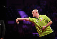 Michael van Gerwen in action during his final match against Peter Wright in the Betway Premier League Darts at the Brighton Centre in Brighton, East Sussex. PRESS ASSOCIATION Photo. Picture date: Thursday 15th May, 2014. Photo credit should read: Chris Ison/PA Wire.