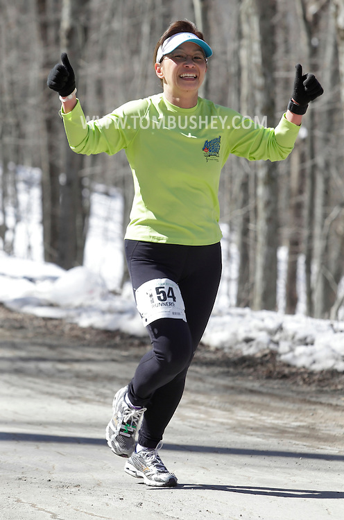 Mamakating, New York - A runner competes in the Wurtsboro Mountain 30K road race on March 20, 2011.