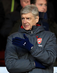 """Arsenal manager Arsene Wenger during the Emirates FA Cup, Third Round match at the City Ground, Nottingham. PRESS ASSOCIATION Photo. Picture date: Sunday January 7, 2018. See PA story SOCCER Forest. Photo credit should read: Mike Egerton/PA Wire. RESTRICTIONS: EDITORIAL USE ONLY No use with unauthorised audio, video, data, fixture lists, club/league logos or """"live"""" services. Online in-match use limited to 75 images, no video emulation. No use in betting, games or single club/league/player publications"""