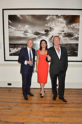 Left to right, CHARLIE MAYHEW, ELIZABETH OFFORD and DAVID YARROW at a private view of photographs by renowned wildlife photographer David Yarrow in aid of TUSK entitled 'Wild Encounters' held at Somerset House on 19th September 2016.