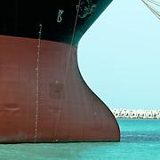 Scenes from a ship yard in Dubai. Ship in water.