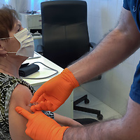 A patient receives a dose of the Sinopharm COVID-19 vaccine in Budapest, Hungary on Feb. 25, 2021. ATTILA VOLGYI