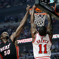 14 March 2012: Chicago Bulls shooting guard Ronnie Brewer (11) dunks the ball on Miami Heat center Joel Anthony (50) during the Chicago Bulls 106-102 victory over the Miami Heat at the United Center, Chicago, Illinois, USA.