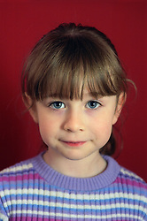 Portrait of young girl looking serious,