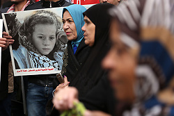 January 1, 2018 - Gaza - Palestinians gather for a demonstration to show their support for the Palestinian prisoners in Israeli jails Khaleda Jarrar and the child Ahd al-Tamimi, in front of International Committee of the Red Cross office in Gaza City, Gaza on January 1, 2018. (Credit Image: © Majdi Fathi/NurPhoto via ZUMA Press)