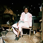 NAIROBI, KENYA – MARCH 9, 2010: An African woman with HIV tends to her livestock.