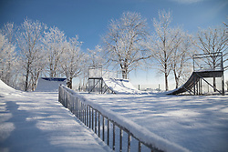 Snow covered sports ramp in playground, Eichenau, F¸rstenfeldbruck, Bavaria, Germany