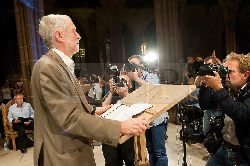 © Licensed to London News Pictures. 05/10/2015. Manchester, UK. Jeremy Corbyn gives a rousing speech to several thousand fans in Manchester Cathedra on day four of the protest weekl. A week of pro-peace, anti-austerity, anti-war, anti-Tory, protests dubbed 'Take Back Manchester' has been  organised by The People's Assembly and timed to coincide with the Conservative Party Conference in Manchester on 4th - 7th Oct 2015. Over 40 events are planned, including a speech by new Labour leader Jeremy Corbyn timed to compete with closing speech of Tory leader David Cameron. Photo credit: Graham M. Lawrence/LNP
