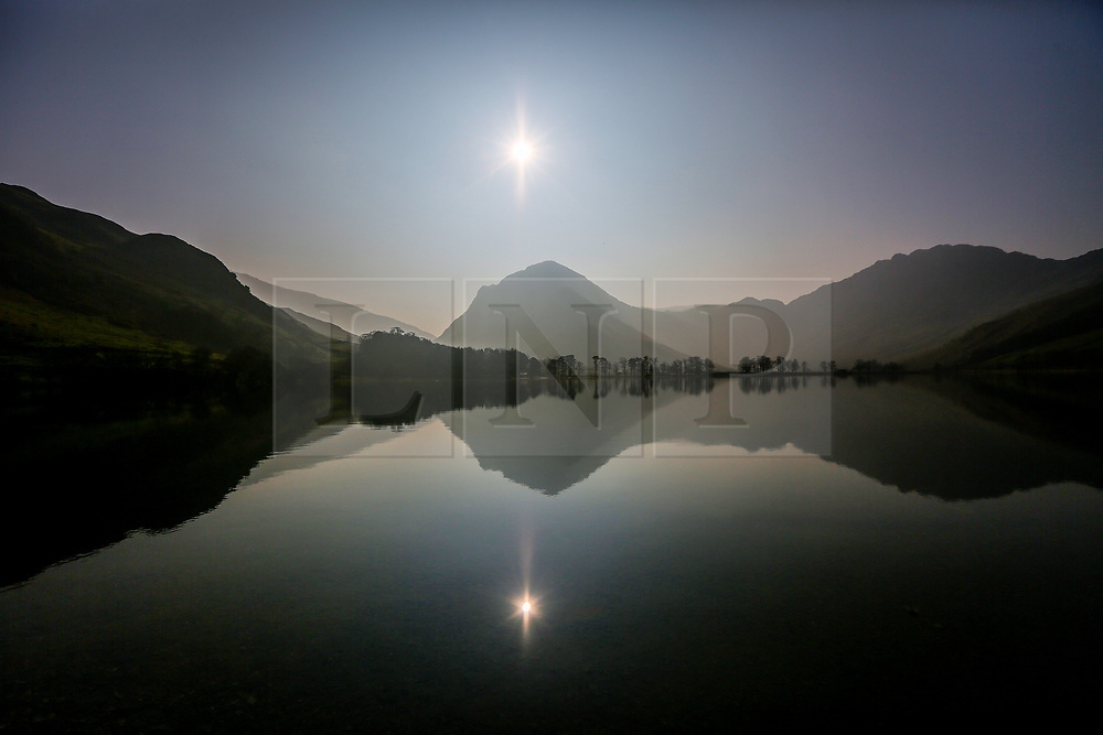 © Licensed to London News Pictures. 28/03/2017. Buttermere UK. The mountains that surround Buttermere reflect in the calm water on another sunny day in Cumbria. Photo credit: Andrew McCaren/LNP
