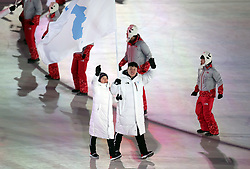 Chung Gum Wang and Yunjong Won lead out North Korean and South Korean athletes during the Opening Ceremony of the PyeongChang 2018 Winter Olympic Games at the PyeongChang Olympic Stadium in South Korea.