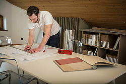 Architect making a blueprint in the office, Bavaria, Germany