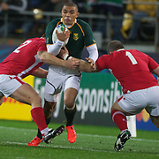Bryan Habana is tackled by Huw Bennet (left) and Paul James during the Wales V South Africa, Pool D match during the Rugby World Cup in Wellington, New Zealand,. 11th September 2011. Photo Tim Clayton