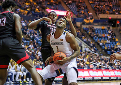 Dec 14, 2019; Morgantown, WV, USA; West Virginia Mountaineers forward Derek Culver (1) makes a move around Nicholls State Colonels guard Andre Jones (13) and Nicholls State Colonels forward Ryghe Lyons (35) during the second half at WVU Coliseum. Mandatory Credit: Ben Queen-USA TODAY Sports