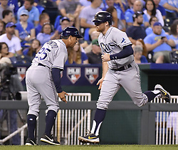 August 29, 2017 - Kansas City, MO, USA - The Tampa Bay Rays' Brad Miller is congratulated by third base coach Charlie Montoyo, left, after hitting a solo home run in the seventh inning against the Kansas City Royals at Kauffman Stadium in Kansas City, Mo., on Tuesday, Aug. 29, 2017. (Credit Image: © John Sleezer/TNS via ZUMA Wire)