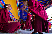 Two monks speak outside the Jokhang Monastery in Lhasa, Tibet.