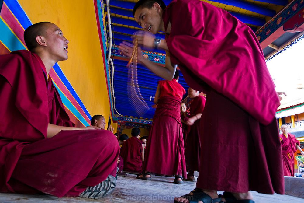 Two monks speak outside the Jokhang Monastery in Lhasa, Tibet.